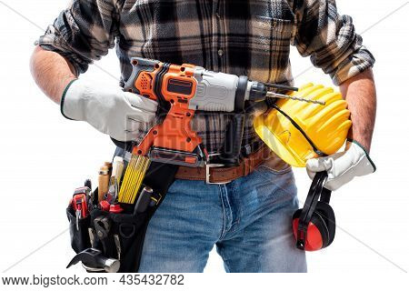 Carpenter Worker At Work Holding The Rechargeable Hammer Drill And Safety Equipment, Isolated On Whi