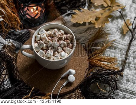 Cocoa With Marshmallows, A Cozy Blanket, Headphones On The Bed. Autumn Home Cozy Still Life, Top Vie