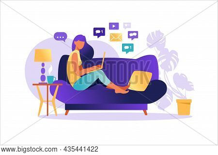 Woman Sitting On Sofa With Laptop. Working On A Computer. Freelance, Online Education Or Social Medi