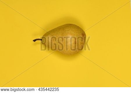 Pears Isolated On Yellow Background. Pears Macro Studio Photo. High Resolution Photo. Full Depth Of