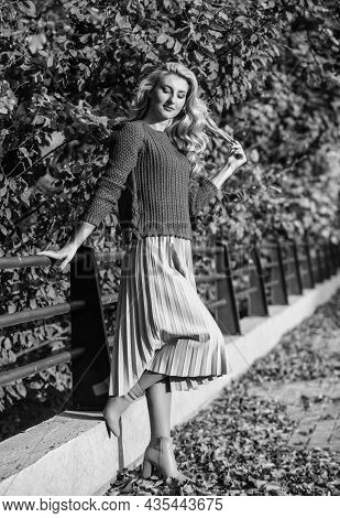 Cute Smiling Woman. Sunny Day With Leaves. Fall Fashion Season. Girl In Corrugated Skirt And Sweater