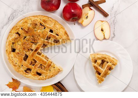 Autumn Apple Pie And A Slice Of Pie. Apple Pie, Cinnamon, Apples And Autumn Leaves. Top View