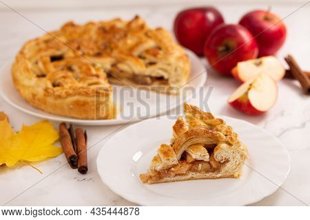 Autumn Apple Pie And A Slice Of Pie. Apple Pie, Cinnamon, Apples And Autumn Leaves