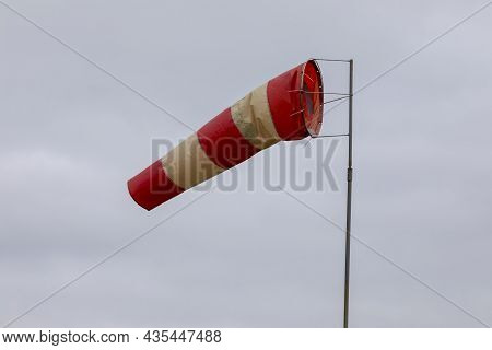 Windsock Indicator Of Wind On Runway Airport. Wind Cone Indicating Wind Direction And Force.
