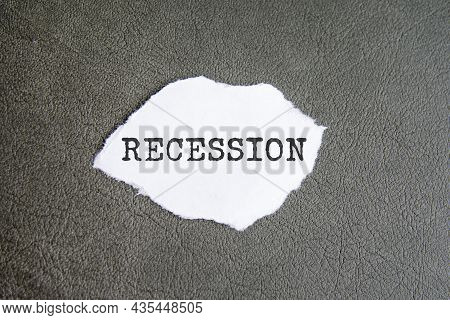 Recession Sign On The Torn Paper On The Gray Background