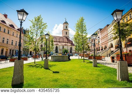 Bolkow, Poland - August 08, 2021. Catholic Church Of Saint Jadwiga In Main Square With Statue Of Pop