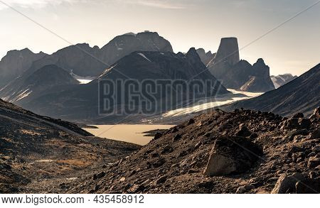 Iconic Granite Rock Of Mt.asgard Towers Above Turner Glacier In Late Summer Afternoon Light. Remote