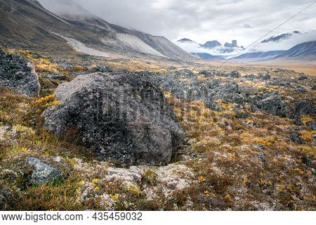 Cloudy Day In The Wild, Remote Arctic Valley Of Akshayuk Pass, Baffin Island, Canada. Iconic Granite