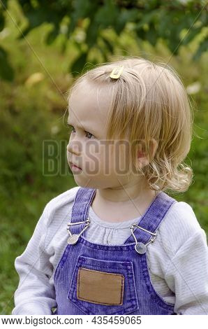 Little Girl In Blue Denim Overalls, Summer At The Cottage In The Garden