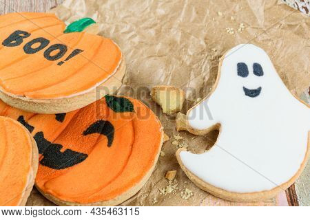 Closeup Of Pumpkin And Ghost-shaped Buttery Cookies On A Brown Paper.