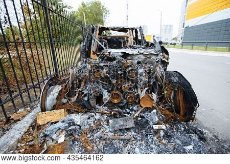 Burnt Exploded Car. Consequences Of Disaster Or Terrorist Attack.