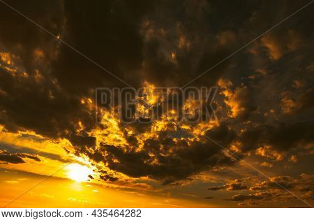 Golden Sky With Dark Clouds . Dramatic Sky With Twilight