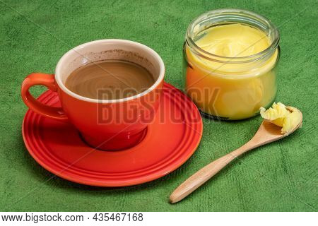 cup of fresh fatty coffee with ghee (clarified butter), MCT oil - ketogenic diet concept