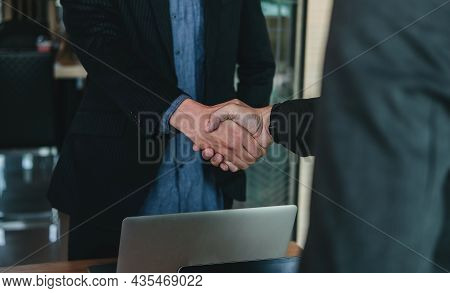 Businessman Handshake For Teamwork Of Business Merger And Acquisition, Successful Negotiate, Hand Sh