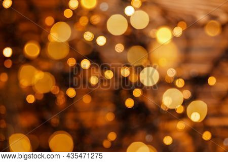 New Year, Holiday Blurred Background. Abstract Gold Bokeh Light Night Luxury Background. Holiday, Be