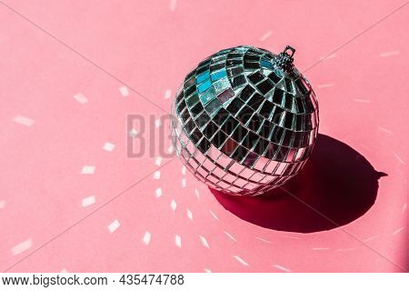 Disco Ball Bauble On Pink Background. Party Concept