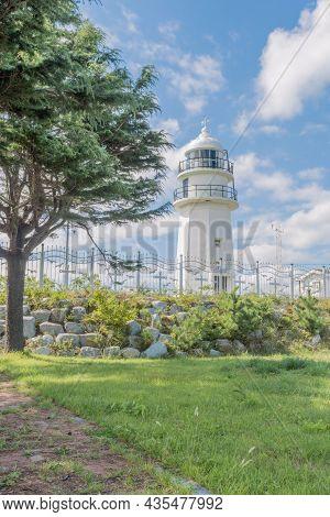 White Lighthouse On The East Coast Of South Korea.