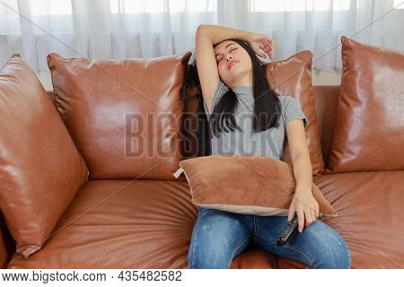 Tv And Happiness Concept. Beautiful Asian Woman In Casual Sleeping On Sofa In Living Room, Holding T