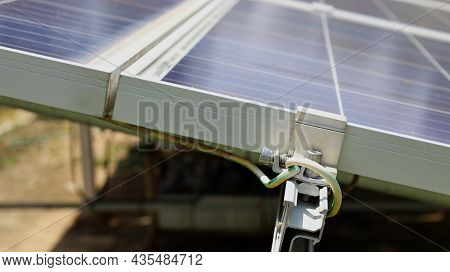 Ground Wires On The Solar Panel. An Overvoltage Or Lightning Protection System Is Mounted Beside The