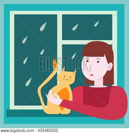 A Young Brunette Strokes A Ginger Cat And Looks Out The Rainy Window. The Girl Is Sad Because Of The