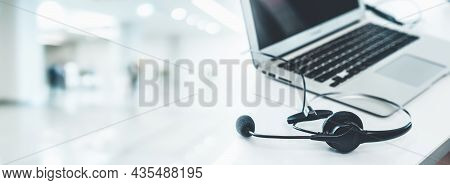 Headset And Customer Support Equipment At Call Center Ready For Actively Service . Corporate Busines