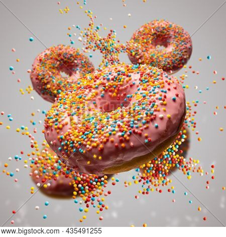 Flying Sweet Donuts With Sprinkels On Grey Background