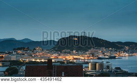 Alesund, Norway. Alesund Skyline Cityscape And Port Terminal In Evening Night Lighting. Historical C