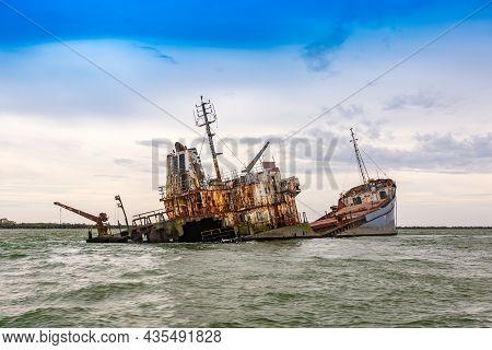 Wrecked Ship In Sea. Rusty Boat Wreck In A Sea
