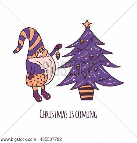 Cute Little Christmas Gnome Stands Next To The Tree And Hangs A Pine Cone Toy. Inscription Christmas