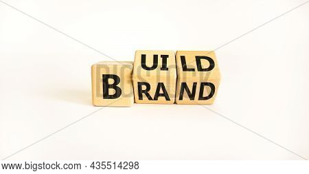 Build Your Brand Symbol. Turned Wooden Cubes And Changes The Word 'build' To 'brand'. Beautiful Whit