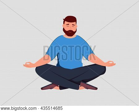 Young Man Sits With Cross-legged On The Floor And Meditates With Closed Eyes. Boy Makes Morning Yoga