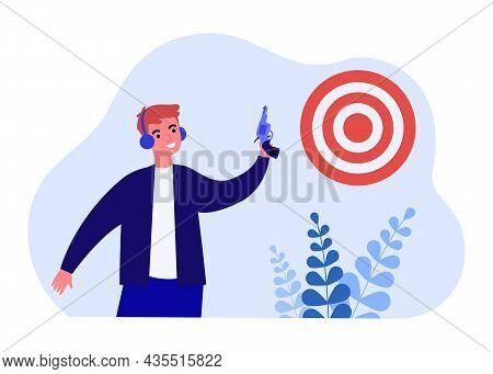 Smiling Man Holding Gun Shooting At Aim Target. Happy Male Gunner In Headphones With Pistol At Sport