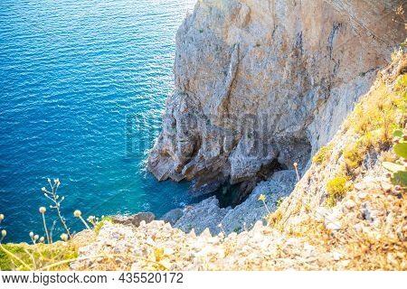 Top View Of The Rocky Coastline Cliff Near Mogren Fort In Budva, Surrounded By Amazing Turquoise Adr