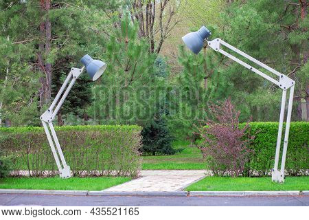 An Unusual Street Lamp In The Form Of A Table Lamp. Strange Street Lighting. Two Creative Lanterns O