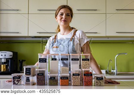 Woman Professional Space Organizer Smiling Posing With Case Boxes For Comfortable Product Storage