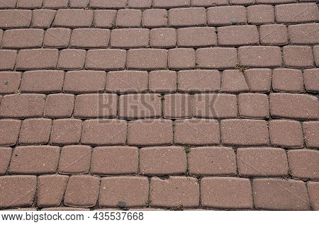 Paving Stones From Square Slabs. Background, Texture, Design. Paving Stones From A Burgundy Block.