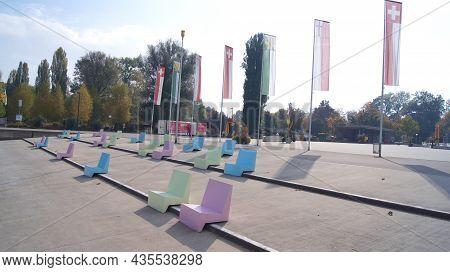 Kreuzlingen, Switzerland - 14 Oct 2015: Kreuzlingen Harbour Promenade With Colourful Seats And A Vie