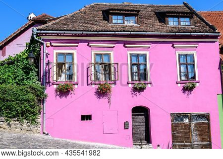 Old Colorful Painted House In The Historical Center Of The Sighisoara Citadel, In Transylvania (tran