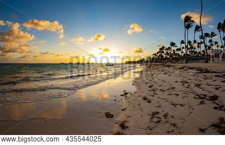 Sunset On A Dominican Beach In Punta Cana. Fish Ey View.
