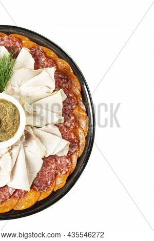 Slicing A Variety Of Meat Delicacies On A Plate With Sauce. Isolated On White Background. Vertical.