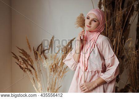 Portrait Of Beautiful Muslim Arabian Woman Wearing Pink Hijab Side View