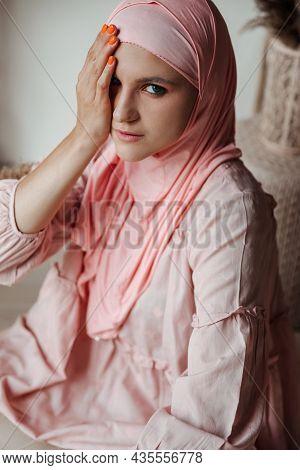 Portrait Of Beautiful Muslim Arabian Woman Wearing Pink Hijab Look At Camera