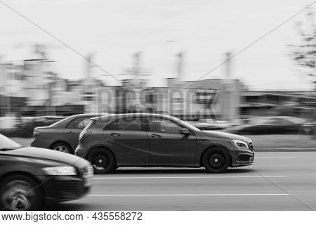Cars Drive At High Speed On The Street. Speeding In Heavy Traffic Conditions. Motion Blur. Riga, Lat