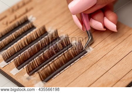 Eyelash Extensions, Lashmaker Tools. Artificial Eyelashes On A White Tablet And Pink Silicone Brush