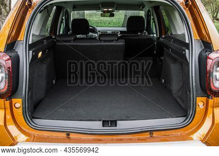 Huge, Clean And Empty Car Trunk Of A Modern Compact Suv. Rear View Of A Suv Car With Open Trunk And