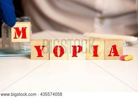 Word Myopia On Wooden Block, Medical Concept