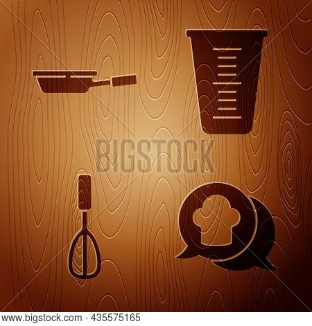 Set Chef Hat In Speech Bubble, Frying Pan, Kitchen Whisk And Measuring Cup On Wooden Background. Vec