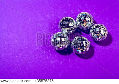 Disco Ball Shines On Purple Background Close Up