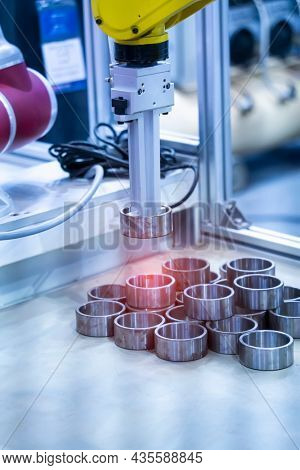 industrial smart robot working with spherical roller bearing and gripping workpiece robot on smart factory , industry 4.0 and technology concept