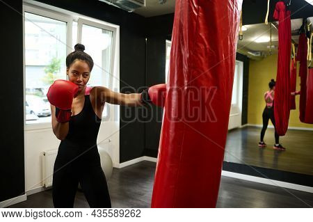 African Concentrated Athlete Woman, Female Boxer With Perfect Physique Wearing Red Boxing Gloves, St